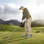 Man playing Golf wear UPF long sleeve shirt sun protection